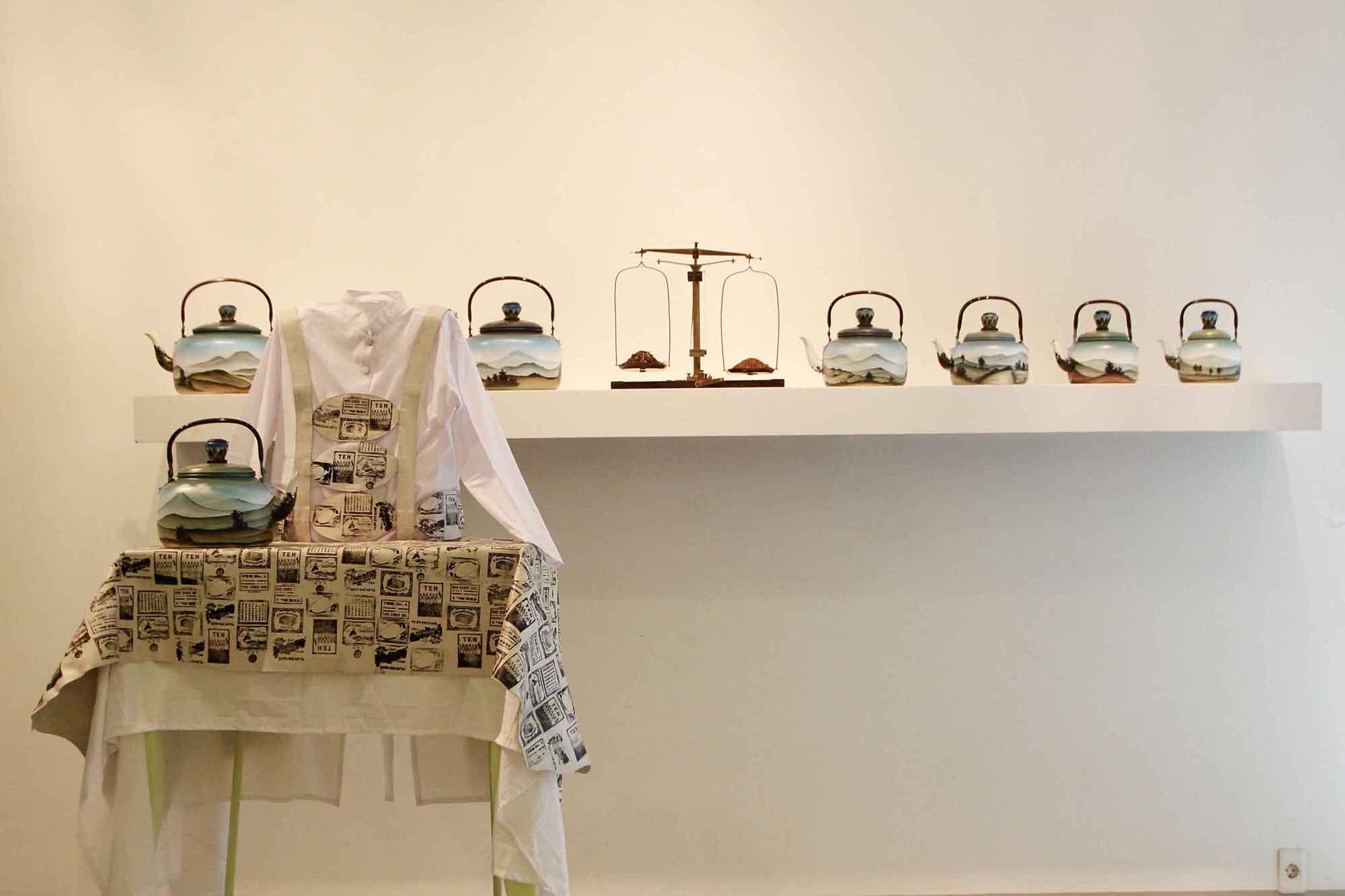 High Tea, Mella Jaarsma, kettles, wood, textile, iron, block print on cow leather, tea, variable dimensions, 2014